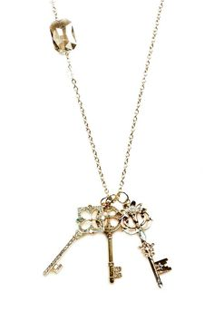 Too Cute! Three gold plated key charms on a long gold plated chain accented with crystals. This beautiful necklace is great with a light V-neck sweater.