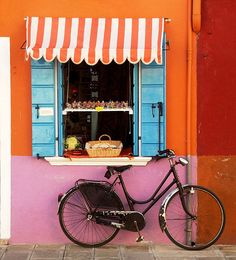 Orange and white stripped awning. Burano, Italy