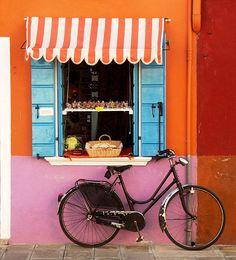 Orange and white stripped awning. Burano, Italy