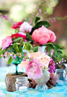 Blooming Centerpieces, pink on a teal tablecloth