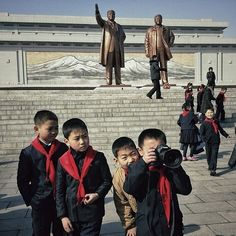 North Korean children playing in Mansu Hill, a square in downtown Pyongyang dedicated to North Korea's great leaders. | 18 Surreal And Revealing Instagrams From North Korea