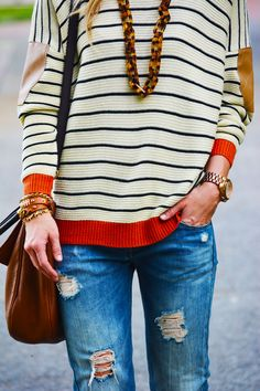 sweater + necklace + ripped jeans.