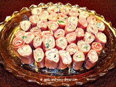 A tasty and easy appetizer, these ham roll ups are a disappearing act at every gathering.