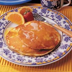 """Sunrise Orange Pancakes Recipe -""""These delectable citrusy pancakes make any breakfast special,"""" assures Dorothy Smith of El Dorado, Arkansas. """"Plus, they're simple to prepare. Breakfast Plate, Breakfast Recipes, Breakfast Ideas, Breakfast Club, Vegan Breakfast, Pancake Recipe Taste, Breakfast Specials, Biscuit Mix, Food Lab"""