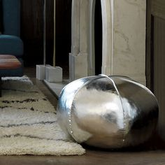Kick back and rest your old dogs — or pull out more seating for guests — with this metallic floor pouff because even pillows are furniture when you live in a small apartment. | 33 Inexpensive Pieces Of Furniture For Your Tiny Apartment