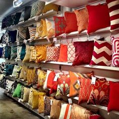 The pillow wall in the Surya showroom is organized by color family. Surya pillows now available at Designer's Touch. Diy Pillows, Cushions On Sofa, Furniture Store Display, Cushion Cover Designs, African Home Decor, Decorative Cushions, Home Decor Furniture, Home Decor Accessories, Room Decor