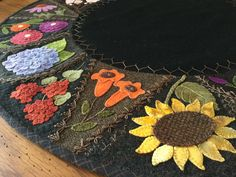 """Wool appliqué with crazy quilt stitching. Hand stitched by Mary Ann Thom. Adapted from """"Flower Garden Crazy Tablemat"""" by Primitive Gatherings. Wool Applique Quilts, Wool Applique Patterns, Wool Quilts, Wool Embroidery, Hand Applique, Felt Patterns, Felt Applique, Crazy Quilt Stitches, Crazy Quilting"""