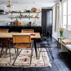 Black floors, morroccan rugs. Loving today's home tour (link to full tour in bio). Louise Desrosier / Milk Magazine #blackfloors #hometour #kitchen