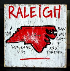 """Wooden Signs, Southern, Hand Painted, Shabby Chic, Wood Art, Distressed Wood Sign: """"Raleigh- A Place That Gets In Your Blood"""". $29.00, via Etsy."""