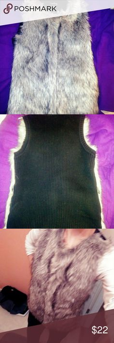 Gray Faux Fur vest Beautiful gray faux fur vest. In perfect condition! It zips up & is very cozy. It's a small petite but I think could easily fit a M size as well. Or if it doesn't fit zipped it could look just as cute wearing it open (unzipped). It is so georgious! Jackets & Coats Vests