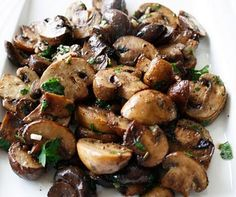 "Fresh Mushrooms, 1/2 Cup Olive Oil. Salt, Pepper. Chop 2 Garlic Cloves. 1 Tsp Chopped Fresh Rosemary. 1 Tsp Chopped Fresh Sage, 1/4 Cup Chopped Fresh Parsley, 1 Tsp Balsamic Vinegar. Preheat oven to 350F. Wipe mushrooms with clean, damp cloth, trim stems. Slice into pieces 2"" in size. Mix olive, garlic, herbs, seasonings in ovenproof casserole dish. Add mushrooms, mix, coating the mushrooms with oil. Bake 30-40 minutes or until cooked through. Remove from heat & drizzle with balsamic…"