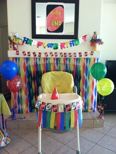 Uno themed decor, shows high chair decor idea and backdrop great for pics, Callie is uno card is half of poster board size and made to look like uno card! This was big whole set up was big hit with guests