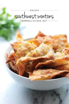 Southwest Wontons - Crispy wontons loaded with southwest, cheesy goodness. And you won't believe how easy this is to whip up! I'd like to experiment with wonton wrappers! Wonton Recipes, Appetizer Recipes, Mexican Food Recipes, Mexican Dishes, Recipes Dinner, I Love Food, Good Food, Yummy Food, Fun Food