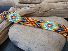 Check out this item in my Etsy shop https://www.etsy.com/uk/listing/288778779/native-american-inspired-beaded-bracelet