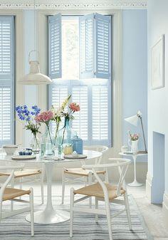 via theshutterstore - blue tier on tier shutters - interior window shutters