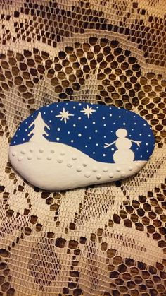 Snowman, 1 of 4 winter themed scenes painted on a Lake Huron beach stone by Cindy P 2017