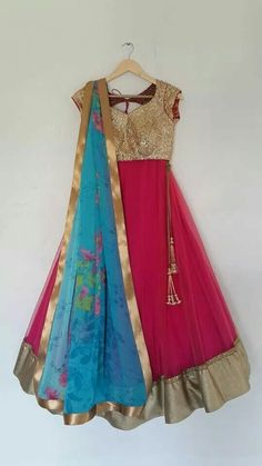 Pink lehanga with gold sequin blose and blue floral dupatta.