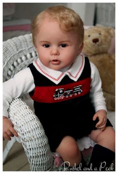 Prince George reborn doll on ebay. Very realistic and lifelike toddler.