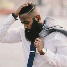 Long beards pair well with a well groomed cut like this bald fade and a hard part.