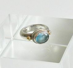 Peyote Bird Blue Topaz Ring Vintage Sterling Silver 14K Gold Ring Size 7   Wonderful chunky sterling silver and 14K gold ring with a solitare blue