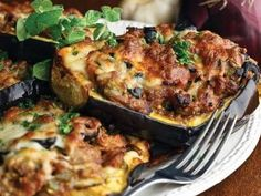 Dinah's Pizzy-Stuffed Eggplants      Thursday, 26 March 2015  in Readers' Recipes      Print         These stuffed eggplants look like they could be absolutely tasty and delicious. They are definitely on my to-make list. You will need:  2 Medium eggplants 1 pound Italian sausage, casings removed ½ cup diced red onion 2 cloves garlic, minced 1 green bell pepper, diced 1 cup sliced button mushrooms 1 (15-ounce) can tomato sauce ½ cup black olives, chopped 1 tablespoon Italian seasoning…