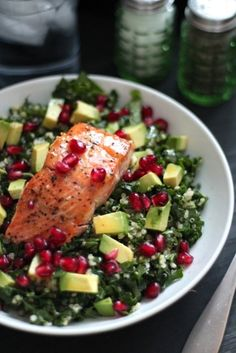 A beautiful and nutritious salad with five superfoods: kale, quinoa, avocado, pomegranate, and wild salmon all tossed with a sweet honey mustard vinaigrette.