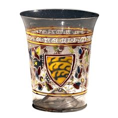 The Aldrevandini Beaker, 1330 This beaker is a particularly well preserved example of Venetian medieval glassware. It is not believed that this glass was made for a particular family, as there are three different heraldic shields on the glass. The Latin inscription on the beaker translates as 'Master Aldrevandin made me'.