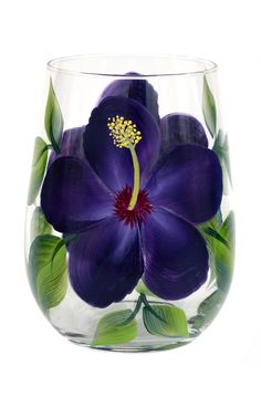 Tropical purple hibiscus petals with deep red centers and bright yellow stamens hand-painted encircling a quality 17 oz stemless wine glass. Sealed and heat-cured for added durability. Top-rack dishwa