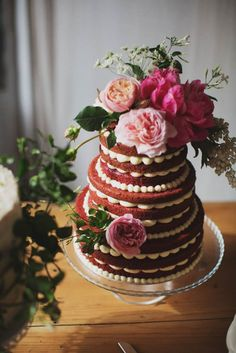 We adore this unique wedding cake idea - red velvet naked layer cake with beautiful peony accents.