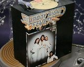 Saturday Night Fever cd box. All boxes are one of a kind, from my original design, handmade from an entire LP cover and record, taking vinyl that has been abused - or loved to death - and making it into something to appreciate in a new way.    Artisit, Kimberly Blinoff