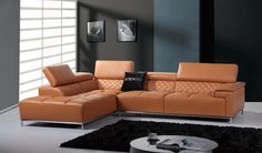 Divani Casa Citadel Modern Orange Italian Leather Sectional Sofa. The Divani Casa Citadel modern leather sectional sofa features a multipurpose, revolutionary design with a Bluetooth audio system and upholstered in genuine leather with tufts. It also features five adjustable headrests and a stainless steel base and legs, exhibiting sturdy construction. It consists of a left facing chaise and a 3-seater sofa with a flat, wide right armrest. Option to upgrade to Italian leather or leather…