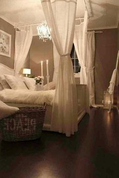 I love this. It's so comfy, relaxing, and romantic all in one. How could you not feel sexy and positive when coming home to a room decorated like this every night?