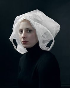 Dutch 'portrait' photographer Hendrik Kerstens' surreal, yet humorous, award winning picture 'Bag' styles his daughter, Paula, like a Vermeer housemaid. Her plastic bag headwear mimics a traditional Dutch cap. Kerstens was inspired during a trip to New York where he saw excessive numbers of bags being given away in stores. This image was his creative and humorous response to an environmental concern.