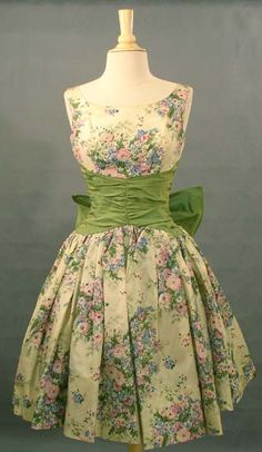 (FRONT) Vintage 1950s floral taffeta dress with gathered iridescent olive taffeta waist, and large bow detail in the back <3.<3.<3 | Vintageous