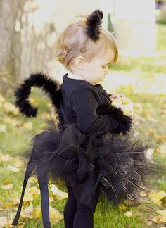 She is adorable! :  Black Cat Costume tutorial for clip-on kitty ears, and perfect kitty tail.