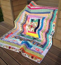 What a pretty scrap quilt. Just a simple log cabin block, but so artistically done. Nice colors,...