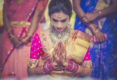 South Indian bride. Kundan jewelry. Jhumkis.Pink silk kanchipuram sari.Braid with fresh jasmine flowers. Tamil bride. Telugu bride. Kannada bride. Hindu bride. Malayalee bride.Kerala bride.South Indian wedding.