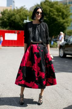 Hot Shots: The Best Street Style at NYFW (Updated!): Eva Chen paired her girlie-cool Tibi skirt with a perforated jacket.