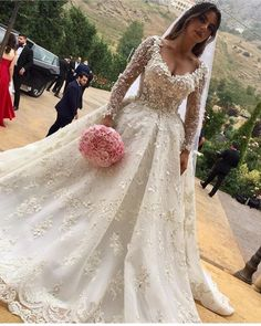 This ornate haute couture wedding gown has sheer long sleeves.  The open v-neck line is also flattering.  We can make elegatn custom #weddingdresses ike this in a price range you can afford.  We are US dress makers who can also make #replicas of haute couture designs for brides who can not afford the original.  Or if your dream dress is discontinued we can recreate it for you. get pricing and mroe details on how it works when you email us directly. DariusCordell.com