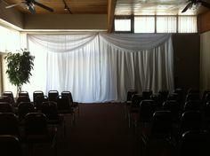 Simple white ceremony backdrop.