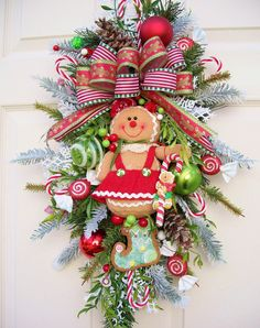 Gingerbread girl swag--Christmas decor  http://www.timelessfloralcreations.com/