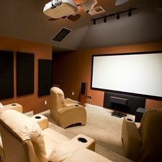 "Do an image search for ""home theater"" and you'll see photo after photo of huge, lavish theaters with seating for up to twenty (or more!) and giant screens. These ideals are every tech geek's dream, but let's face it; most of us don't have the money or space. Instead, home theaters are usually placed in living rooms or, if you're lucky, a small bedroom or office dedicated to entertainment."