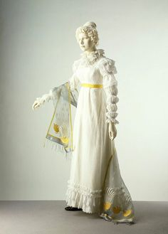 Dress ca. 1820  This example has a gathered collar in imitation of the ruffs of 16th c dress. The sleeve, with a series of puffs down the arm, was known as a 'Marie' sleeve, after a similar style worn by Marie de Médicis, Queen of France at the beginning of the 17th c.