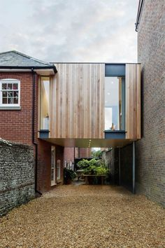 British architect Adam Knibb has extended a house in a converted school in Winchester, England, by building a timber box above a seldom-used entryway.Adam Knibb Architects was asked by the owner to … Architecture Extension, Residential Architecture, Interior Architecture, Interior And Exterior, Interior Design, Parasitic Architecture, Architects Journal, Extension Designs, Extension Ideas