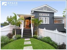 I like the manicured lawns leading to the old queenslander style. I like the house colours as well