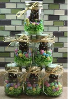 Easter ideas - I did this last year for prizes. I used edible easter grass & different colored m&m's for each jar.