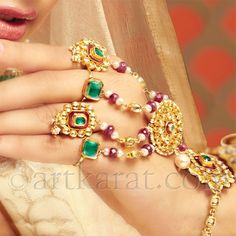Hathphool: The bride wears rings in all fingers of both her hands, which are connected with strings to a central flower or medallion that covers the upper part of the hand. The medallion is connected to a bracelet through a string.