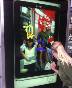#HTC #tablet launch   digital interactive bus shelters   - good idea, use the shape of ipad and make shop window which is interactive!!