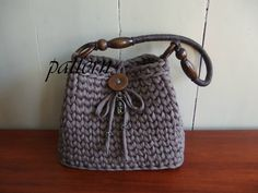 Crochet pattern t-shirt yarn bag with wooden handle.