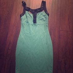 Mint colored Von Maur dress size M Super cute fitted dress with leather straps. Perfect for a night out! No tags, but never worn. Von maur Dresses Midi